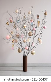 Christmas tree made from branches and vintage balls and decoration. Alternative Christmas tree