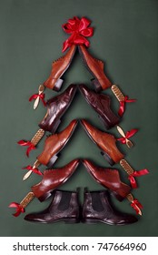 Christmas tree made of classic polished oxfords brogues shoes on green leather background. Creative christmas tree. Christmas sales .Shoes shop christmas.Top view