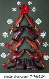 Christmas tree made of classic polished oxfords brogues shoes on green leather background. Creative christmas tree. Christmas sales .Shoes shop christmas.Top view.Snowflakes on background