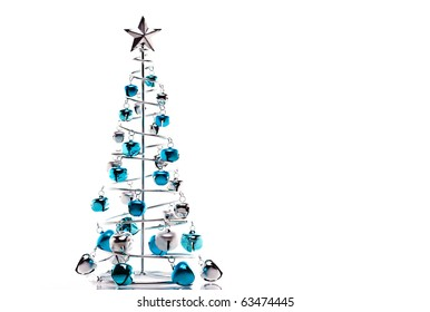 Christmas tree made out of blue and silver jingle bells isolated on white