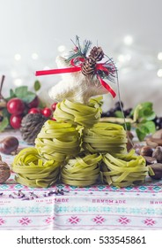 A christmas tree made with pasta nests