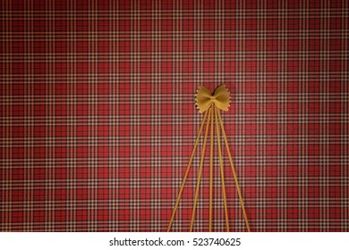 Christmas tree made of pasta on red squared background. Flat lay. Top view. Winter holidays concept