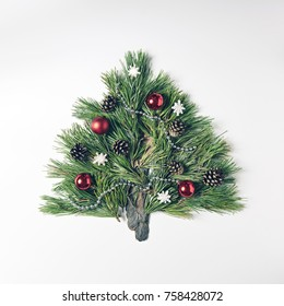 Christmas Tree made of Pine Branches. Merry Christmas and Happy New Year Concept. Flat Lay.