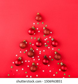 Christmas tree made of red balls and color confetti.