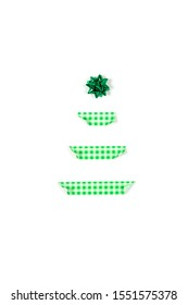 Christmas tree made of scotch and star decoration. Holiday concept. Alternative Christmas tree. Flat lay. Isolated on white background.