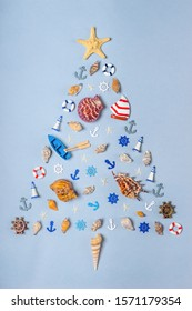 Christmas tree made of various decorative ocean items: seashells, starfish, vessels, lighthouses, lifebuoys, steering wheels, anchors. New year holidays at sea, travel, cruise, voyage concept