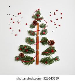Christmas Tree made of Winter Foliage and Cinnamon Sticks. Holiday Concept. Flat Lay