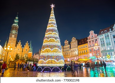 Christmas tree at Market square (Rynek) and Christmas market at night in Wroclaw, Poland