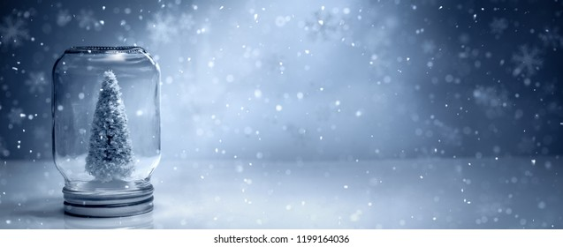 Christmas tree in mason jar with falling snow
