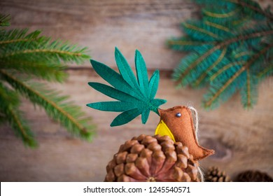 Christmas tree. Medical cannabis leaf in the bird's beak.  marijuana new year product recreation
