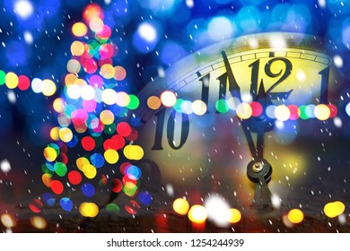 Christmas tree with new year clock before midnight
