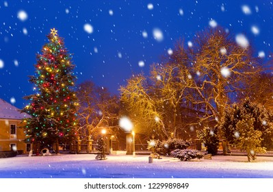 Christmas tree at night in the snowfall