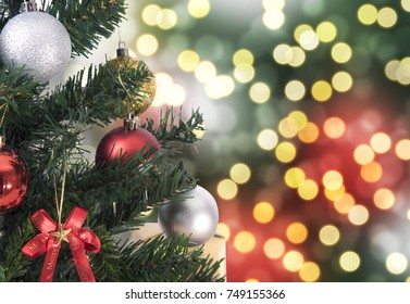 Christmas tree on abstract light golden bokeh background.