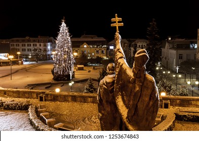 Christmas tree on Andrej Hlinka square in Zilina with statue of st. Cyril and Methodius in a foreground - Slovakia