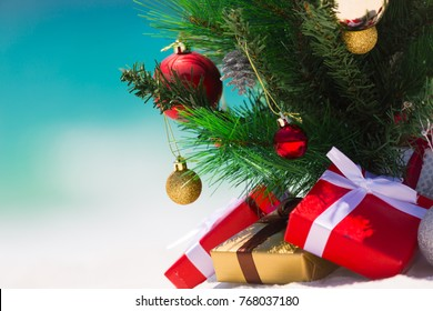 Christmas tree on a beautiful white sandy beach paradise in the summer.  Closeup with background blur suitable copyspace,