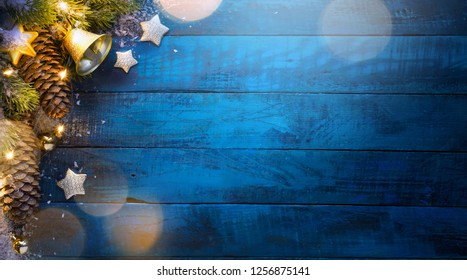 Christmas tree on blue wooden background
