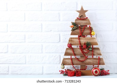 Christmas tree on brick wall background