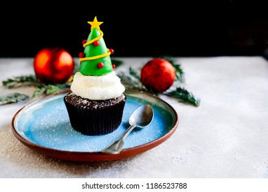 Christmas tree on the cake cup,selective focus and blank space