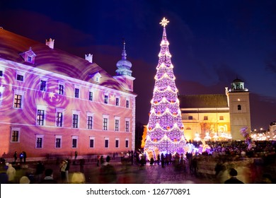 Christmas Tree on Castle Square at the Old Town of Warsaw in Poland, illuminated at night.