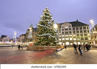 Christmas Tree on Dam Palace in Amsterdam the Netherlands at twilight