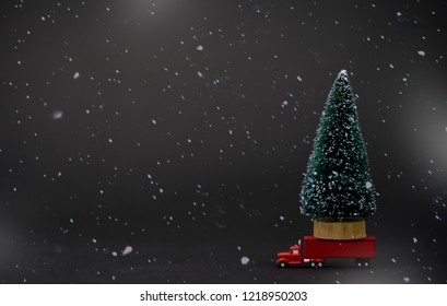 Christmas tree for christmas on red semi truck delivering Christmas or New Year gifts in winter time.concept for buy and shop decoration on winter season.