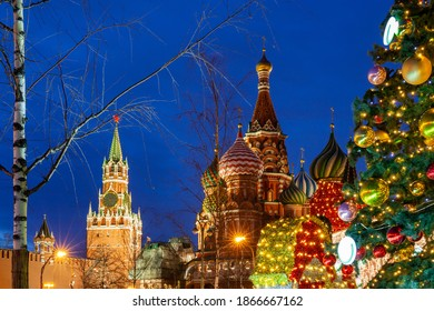 Christmas Tree on the Red Square with the Saint Basil's Cathedral and Spasskaya Tower on the background, Moscow, Russia