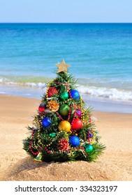 Christmas tree on sand on the beach