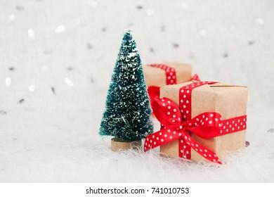 Christmas tree and ornament on defocused lights.
