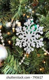 An Christmas tree ornament shaped like a snow flake.