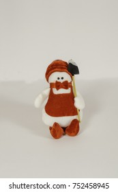 Christmas tree ornament snowman in red Kostochka and hat on white background