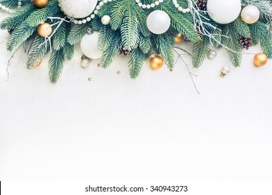 Christmas Tree Pine Branches and Christmas balls on a light background.