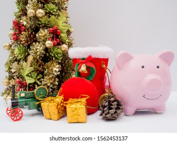 Christmas tree and pink piggy bank with decoration on white background, Have a nice holiday on this Christmas.
