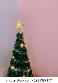 Christmas tree with pink and white background