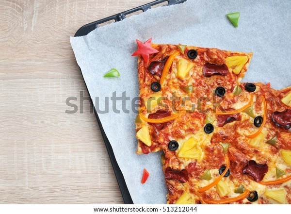 Christmas tree pizza - easy, healthy and delicious fun food party treats for kids top view blank space for text