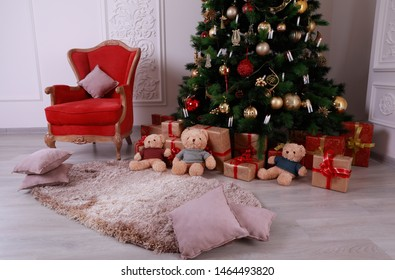 Christmas tree and red armchair in the beautiful interior