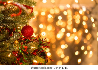 Christmas tree with red ball ornament bokeh light background