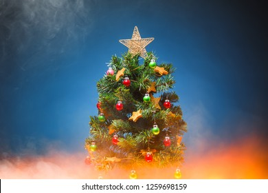 Christmas tree with red glow light, blue background