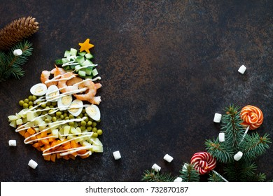 Christmas tree from a salad olivier on a brown rusty stone or metal background.  Beautiful Christmas and New Year background for food top view of a blank space for text.