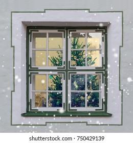 Christmas tree seen through a beautifull window. Winter, New Year background, postcard.
