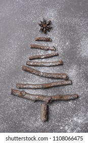 Christmas tree shape made of twigs and sprinkled with flour to look like a dusting of snow