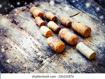 Christmas tree shaped by corks on wooden background