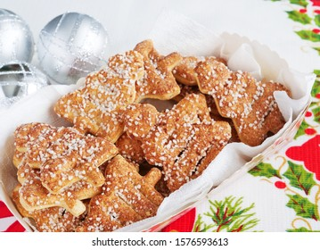 Christmas tree shaped cinnamon biscuits in a paper food basket on Christmas table