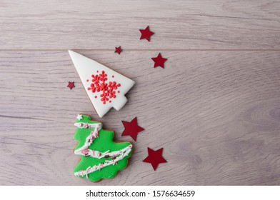 Christmas tree shaped cookie decorated with fondant.