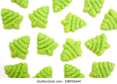 Christmas tree shaped green biscuits isolated on white background