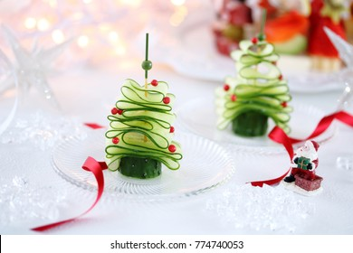 Christmas tree from sliced fresh cucumber and pink pepper cones