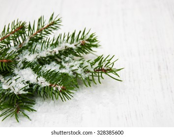 christmas tree with snow  on a old wooden background
