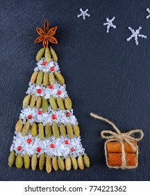 Christmas tree of spices on a dark  background