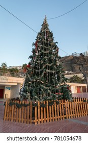 Christmas tree standing at Playa de Amadores beach on Gran Canaria island in Spain.