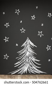 Christmas tree and stars with chalk on blackboard