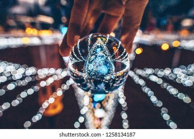 Christmas tree through the glass ball